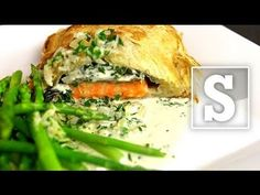 A great looking fish supper that can be prepared ahead and baked off when required. perfect for dinner parties... it's simple, tasty and showy. Served with a white wine cream sauce and some beautifully seasonal asparagus.    Get the Recipe http://www.sortedfood.com/salmonencroute    Follow us on Facebook http://facebook.com/sortedfood    Check o...