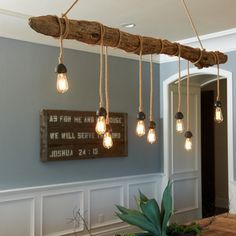 Ceiling light Idea for a branch of #driftwood. More things you can do with a long branch of driftwood here: http://www.completely-coastal.com/2009/11/what-you-can-do-with-long-piece-of.html
