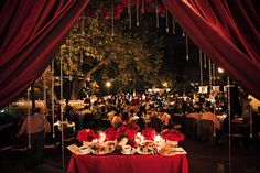 This is gorgeous. I had thought that I wouldn't like much red, but I'm loving this combination of a romantic outdoor reception with the red and crystals to make it dramatic