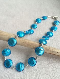 Vivid and vibrant turquoise Murano glass smartie necklace with sterling silver beads and clasp