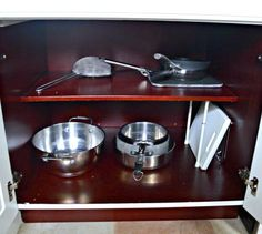 s 13 incredibly useful tension rod ideas you haven t seen yet, crafts, organizing, repurposing upcycling, Organize your kitchen cabinets