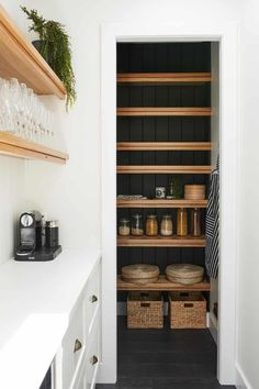 timber shelves and black vertical groove paneling Cottage Renovation, Home Renovation, Outdoor Stone Fireplaces, Timber Shelves, Shed Interior, Queen Room, Eclectic Modern, Pantry Design, Walk In Pantry