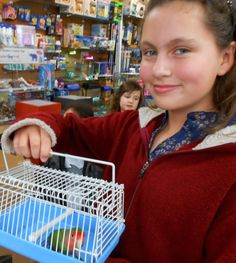 Rebecca and her new pet are a pretty pair of lovebirds at The Animal Store. #pets #animals #WordlessWednesday