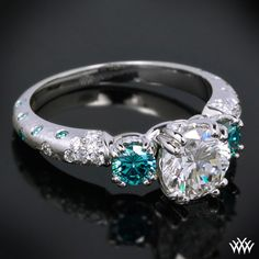 3-stone engagement ring with twho blue side-stones.. pretty awesome