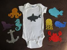 Ocean Baby Shower Activity  Ocean Themed Baby by bingecrafter - this is a neat idea, iron-on sea creatures to make custom onesies - potential shower activity