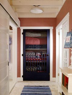 Quilts on Display  For a charming decorating touch, replace a linen closet door with an old-fashioned screen door. Red, white, and blue quilts or bedding can remain on display year-round.