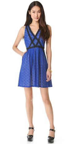 328.00 FREE SHIPPING at shopbop.com. Contrast crocheted ribbon creates an elegant contour on this lace Marc by Marc Jacobs dress. Pleats add volume to the skirt, and pockets sit at the hips.