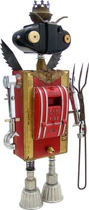 """Fobot by Amy Flynn.  Name: Mephist-O-Matic  D.O.B.: 10/16/11  Height: 19""""  Principal Components: Fire alarm, candy tin, camera, anti-kickback pawls, test tube clamps, cleat, barbecue fork, oil lamp part, jello molds, hydraulic fittings"""
