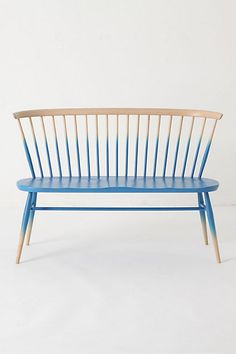Ercol designed this modern-timeless bench in 1956, inspired by the traditional silhouette of the Windsor chair. Each blue ombre-lacquered seat is manufactured in the UK from solid beech and elm, using a mix of hand craftsmanship and up-to-the-minute technology