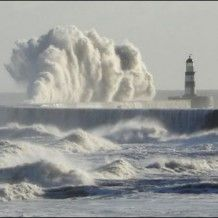 Ireland, lighthouse, wave.I want to go see this place one day.Please check out my website thanks. www.photopix.co.nz