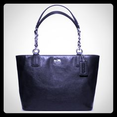 """HPAuthentic Black Coach Madison Handbag Perfect condition.  #20466.  Only used a couple of times.  Only sign of use is INSIDE the inside zip pocket there is a stain.  Black very soft leather, silver chain handles woven with leather, zip top closure, inside purple silky fabrics with two multi-function pockets and inside zip pocket, flat bottom.  Includes dust bag.  Approx measurements are: 9 1/2"""" handle drop, 14 1/2"""" L x 9 3/4"""" H x 5"""" D.  For additional pictures see the top of my closet or…"""