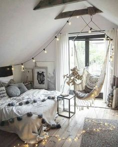 Grey and white and black with amazing bulb lights. Brilliant composition for this boho chic bedroom