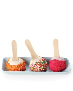 What a great, smart idea for birthday parties. Pre-scoop your ice cream, insert a small wooden spoon, roll in sprinkles, refreeze. When it's party time, it's ready!