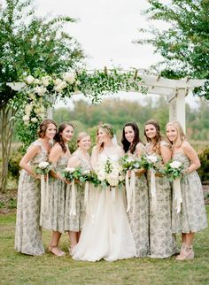 Floral boho chic bridesmaids: Floral Design: Lily Greenthumb's Wedding & Event Design - http://www.stylemepretty.com/portfolio/LilyGreenthumbs Wedding Dress: Modern Trousseau - http://www.moderntrousseau.com/ Bridesmaids' Dresses: Asos - http://us.asos.com   Read More on SMP: http://www.stylemepretty.com/2017/01/12/a-fashion-bloggers-unique-southern-wedding/
