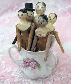 Sugar Bowl full of miniature antique Peg Dolls.