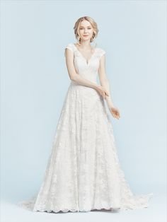 A romantic A-Line wedding dress with a V-neckline. Perfect for a church wedding. Bridal Gowns, Wedding Dresses, Church Wedding, Bridal Collection, Lace Detail, Supermodels, Catwalk, Fashion Show, Flower Girl Dresses
