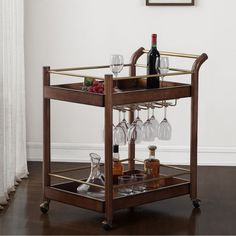 Entertaining at home is easier with this two-tiered bar cart with plenty of room for drinks and glassware.  Functioning wheels make it easy to transport drinks from the kitchen to the living room or wherever guests prefer.