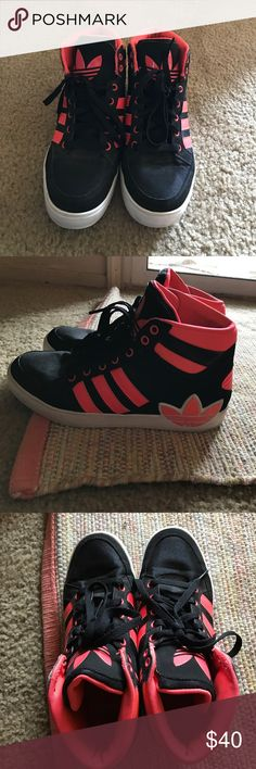 Adidas shoes Teens/women size 7 worn a couple of times been sitting in closet for 2 years now. They are black and like a coral/highlight pink (NO TRADES!!!! NO RETURNS!!!! NONE AT ALL!!!) Adidas Shoes Sneakers