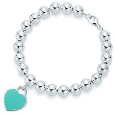 Return to Tiffany™ heart tag in sterling silver on a bead bracelet,... ($445) ❤ liked on Polyvore featuring jewelry, bracelets, sterling silver bangles, heart jewelry, heart-shaped jewelry, bead jewellery and heart bangle