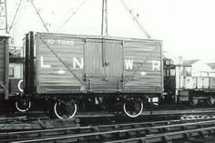 LNWR 10 ton Covered Van No. 55251 - This is a good example of an LNWR van. The arrangement of the doors provides a convenient ramp between the vehicle and the platform for loading and unloading.