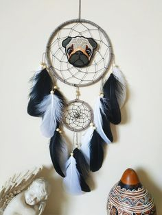 Cute Pug Lover Gift Dream Catcher Wall Hanging Dog Lover Gift Beautifully crafted one of a kind dreamcatchers! Perfect for: home decor, nurseries, children's bedrooms, birthdays, parties, photo props, and much more! Makes a thoughtful gift for a Loved one or yourself. Measurements: The Dreamcatcher ring 6 inches (15 cm.) and 3 inches. 18 inches from top of the ring to bottom of feathers ( not including cotton hanger) Dream Catchers For Sale, Dream Catcher Decor, Dog Lover Gifts, Dog Lovers, Goose Feathers, Cute Pugs, Good Vibes Only, Gifts For Girls, Wooden Beads