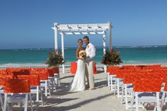 """Gorgeous beach wedding in Punta Cana. Karen Bussen's """"Tropical Promise"""" package is simply stunning inspired by tropical colors of a tropical sunset #PuntaCana #DestinationWedding"""