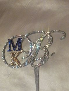 Swarovski Crystal Monogram Cake Topper - pretty and different!  $75.00, via Etsy.