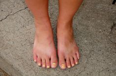 Amber shows off her beautiful size 10 feet on the streets of Jerome, AZ.  She had a neat yellow pedicure becasue she was recently in a wedding where the briadal party wore yellow.  See all kinds of beautiful pedicures in the book Best Foot Forward.  Check it out at www.bookerpress.com