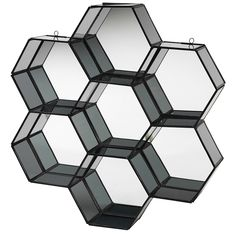 This mirrored glass wall panel from Danish homeware brand Broste Copenhagen resembles a honeycomb with seven separate hexagonal compartments. It can be used as a shelf or simply as a decorative object - perfect in the bathroom. A smaller brass finished panel is also available and they look very good as a pair. ;Material: Iron and glass Size: Width 42 x length 45 x height 8 cm Colour: Black Wall Shelves Design, Glass Shelves, Mirror Panel Wall, Black Hallway, Taupe Walls, Broste Copenhagen, Wall Ornaments, Nordic Home, Mirrors