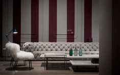 Chester Moon - Baxter. Renown for a beautiful, luxurious & diverse range of products, each one uniquely hand crafted. The Moon is handmade of tufted leather and is characterised by a cloud-like design with rounded edges.
