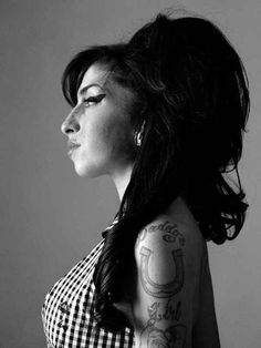 Amy Winehouse (1983-2011) - English singer-songwriter known for her deep contralto vocals and her eclectic mix of musical genres, including soul.  London 2010. Photo  © Bryan Adams.