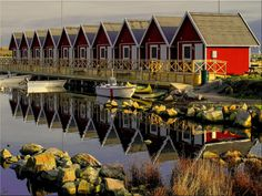 Karlskrona Sweden, red cottages in the Port of Sandhamn - IRR