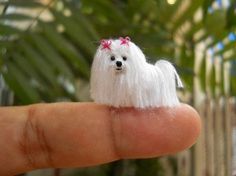 Mini Crochet Amigurumi Delightful Tiny, Micro, and Mini Crochet Posted on August 21, 2014 by Crocheters  It's amazing what can be done with embroidery and sewing thread plus steady hands. These are just a few examples of great tiny, micro, and mini crochet pieces. (The tiny crochet hook is pretty neat, too) Mini Crochet Maltese by SuAmi on Etsy -