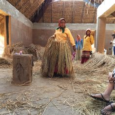 artisans creating a thatch roof!!