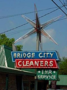 Bridge City Cleaners, TX. What a fabulous old sign!