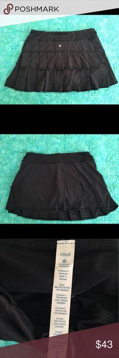 Lululemon black pacesetter skirt Lululemon black pacesetter skirt. Back zippered pocket, hidden pockets in waistband and built in shorts. Excellent condition. lululemon athletica Skirts