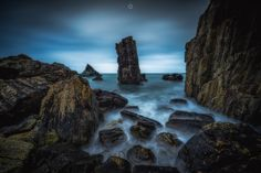 Worn Apart - A sea stack off the coast of Portsoy in Aberdeenshire, Scotland, on a dark and stormy day.
