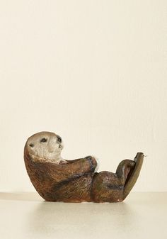 Your colleagues often stop to swoon over your oh-so adorable otter-shaped tape dispenser by Streamline! Lying back as if its floating in the ocean, this brown ceramic sea otter holds the adhesive roll between its clawed paws while the metal tape-cutter sits at the end of its long muscular tail. We promise, office supplies don't get any cuter than this semi-aquatic critter!