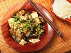 Braised Eggplant with Tofu in Garlic Sauce Recipe Main Dishes with japanese eggplants, chinkiang vinegar, Shaoxing wine, corn starch, soy sauce, brown sugar, chili paste, toasted sesame oil, vegetable oil, garlic, scallions, mustard, firm silken tofu, coriander leaf