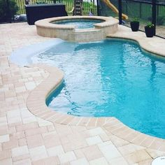Anyone love the idea of a beach entry for their pool? #Tampa #PoolBuilders #Lakeland #PoolDesign by olympuspools Creative backyard pool designs.