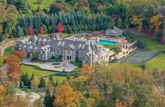 """[divide] Location: 1 Frick Drive, Alpine, NJ Square Footage: 30,000 Bedrooms & Bathrooms: 12 bedrooms & 19 bathrooms Price: $49,000,000 The incomparable """"Stone Mansion"""" estate, located at 1 Frick Drive in Alpine, NJ, has been re-listed yet again. Situated on"""