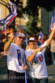 Acadian;people;celebration;costumed revelers;Tintamarre;parade;Caraquet;New Brunswick;Canada;cultural;festival;culture;nationalism;colourful;fun;tourism;destination