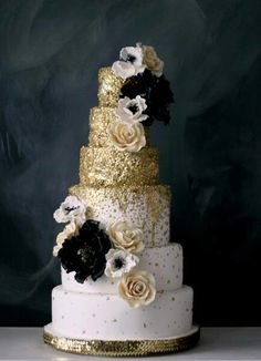 Tiered gold cake by The Caketress - just change the color of the flowers and it'll fit your theme!