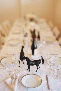 plastic animal crafts chalkboard place cards - maybe not animals but anything else. Cheap and easy.