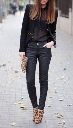 black sheer blouse + black mid zipper jacket + leather pant +Leopard booties +sequin clutch