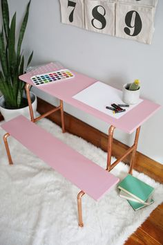 Create a trendy copper pipe and blush pink children's desk with this step-by-step tutorial on www.aBeautifulMess.com