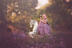 Stylized Child Photography. Baby Photography. Couture Photography. Second Birthday Photo. Baby girl photo idea Child couture dress. Anna Triant Couture Gown. Paint the Sky Photography. Carousel Horse Session. Little girl photo ideas.
