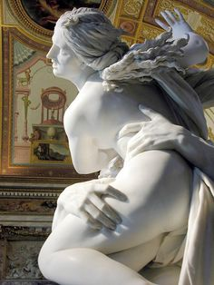 Bernini's -persefonentaking by pluto-at first this sculpture was place in a glass jar because people coyld not stop touching it thinking that it was real flesh they were touching-notice the details of how pluto's hands are grabbib poor persephone-amazing bernini