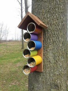 Bird feeders are a great way to enjoy wildlife at its best. If you live in an area that has many birds, a couple of strategically placed feeders will. diy garden art 15 DIY Bird feeders That Will Fill Your Garden With Birds Garden Crafts, Garden Projects, Garden Art, Garden Kids, Diy Garden, Herb Garden, Tin Can Crafts, Diy And Crafts, Crafts For Kids