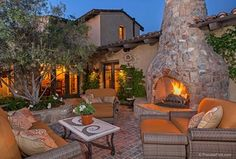 Mediterranean Patio with Raised beds, exterior terracotta tile floors, exterior tile floors, outdoor pizza oven